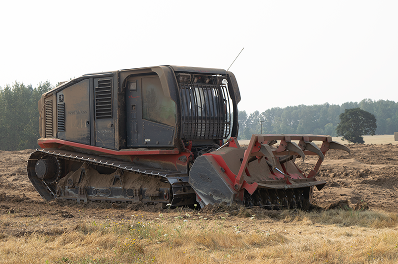 A machine sitting in a field.