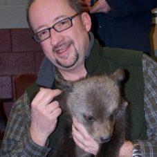 Heiko Jansen holding a bear cub.