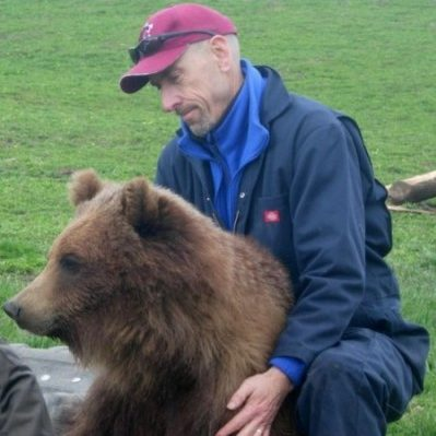 Charles Robbins with a bear.