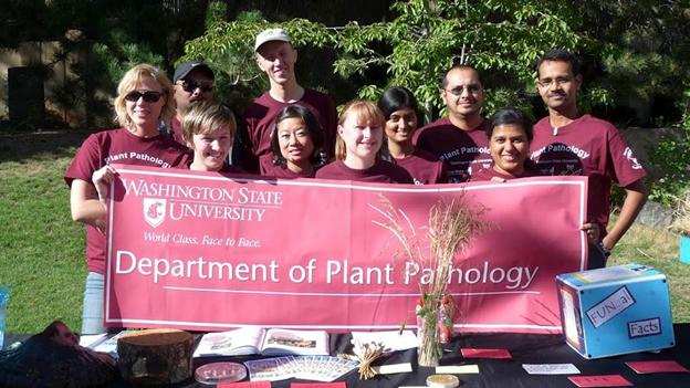 Dept of Plant Pathology students holding the Department of Plant Pathology banner