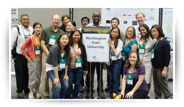 Faculty and students representing WSU at a poster presentation