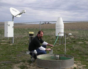 Brian Fode taking the evaporation readings