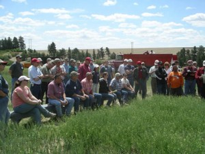 This is an image of a group listening to a field tour at a Field Day.