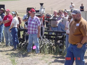 This is an image of a crowd listening to a field tour at a Field Day.