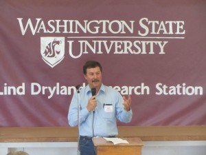 This is an image of State Senator Mark Schoesler talking at the 2014 Field Day.