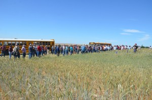 crowd at a field tour stop.