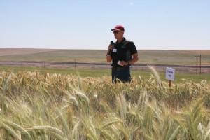 Bill Schillinger speaking at a field tour stop.