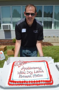 Steve Schofstoll holding the cake.