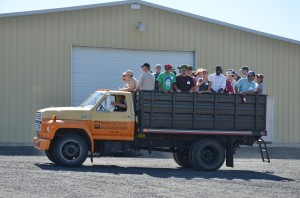 people in the back of a wheat truck.