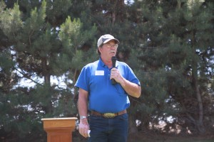 Larry Cochran speaking during the noon program.