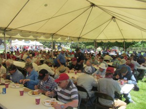 people having lunch under tents at Field Day.