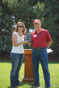 Veronica Schoesler Clinton recieving an award on behalf of her father.