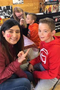 CAHNRS Human Development Club students face painting Coug`fans