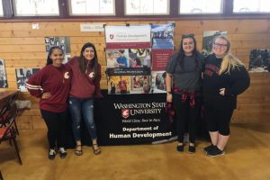 CAHNRS Human Development Club with a Department of Human Development display at a tailgating event