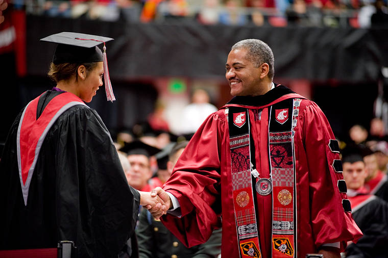 president_floyd_congratulates_a_wsu_graduate_during_the_fall_commencement_ceremony