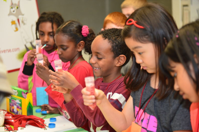 Dr. Universe teaches children how to extract DNA from strawberries during Kids Science and Engineering Day sponsored by the Society of Women Engineers.