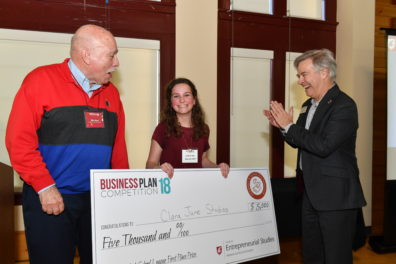 Student, sponsor, and College of Business dean with award check