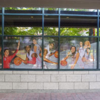 Photo of athletes as decals in windows