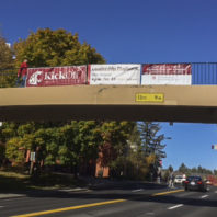 Three bridge banners hanging up next to each other