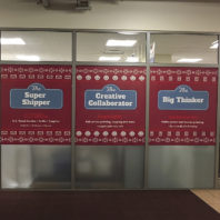 CougPrints Plus holiday marketing window decals