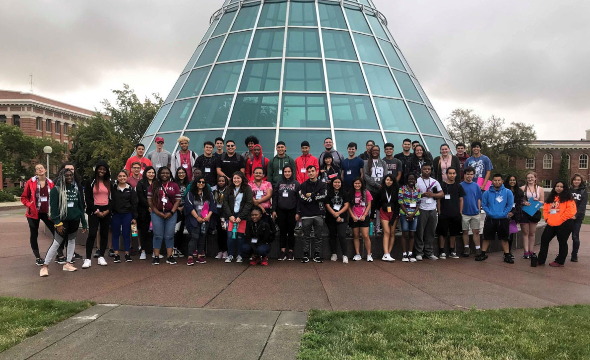 New WSU LSAMP students pose together for a group photo at the outdoor viewing area around the iconic skylight of the Terrel library.