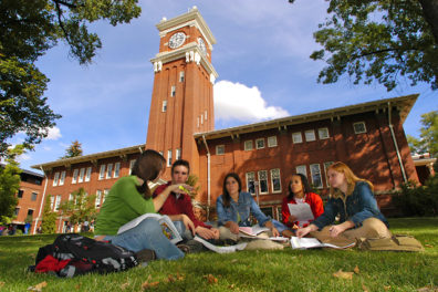 Student group meeting on the lawn below Bryan Tower.
