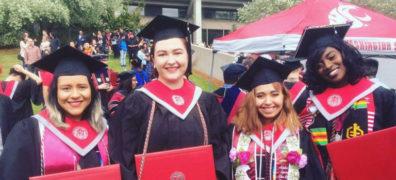Graduating students in cap and gown regalia.
