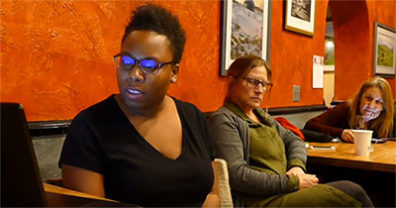 At Open Mic in Pullman, ///name??// reads aloud as Linda Russo and Donna Potts listen.