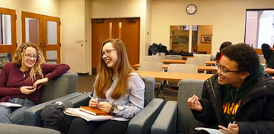 Three young women in the Passport Program share a laugh.