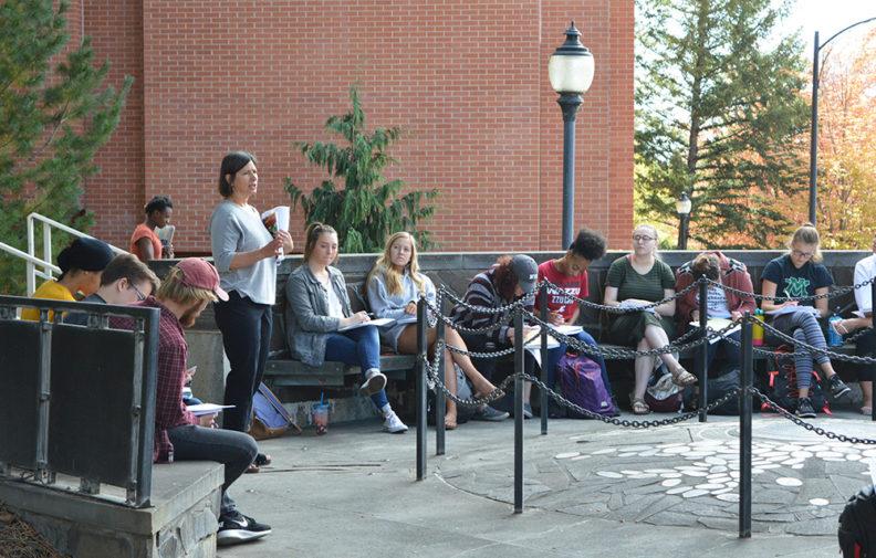 Pam Thoma teaching a class outside.