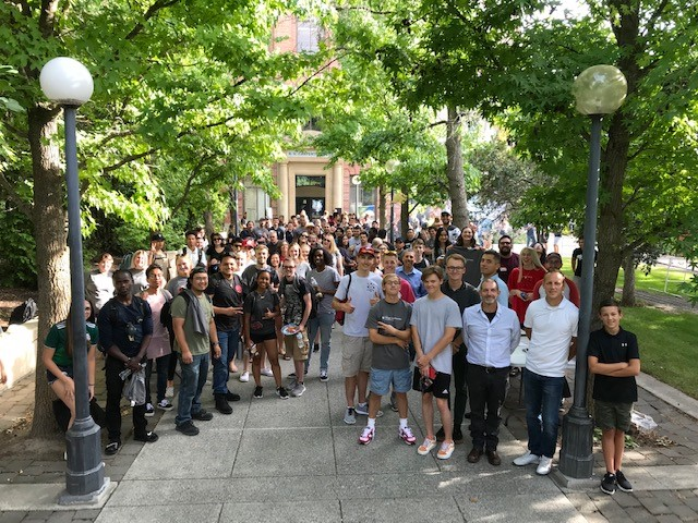 Students and faculty outside Carpenter Hall during Welcome BBQ fall semester.
