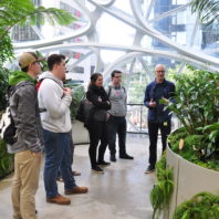 Mark Brands (in blue shirt) tours students at the Amazon Spheres during the landscape architecture study tour in Seattle Fall 2019.