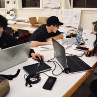 Students on a team work together in studio during the Hack-a-House event.