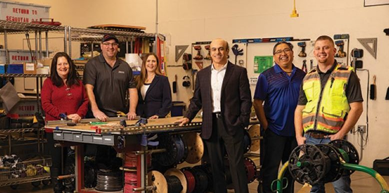 Sequoyah Electric President Mahmood Ghassemi, third from right — with, from left, Michele Amato, Tim Ostlie, Cheryl Nagel, Thurman Woods and Ryan Cruth.