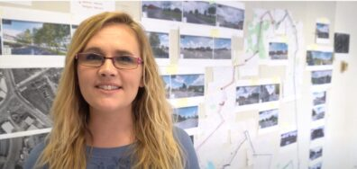 Landscape Architecture student, Jaime Kemple, stands in front of design projects for a video.