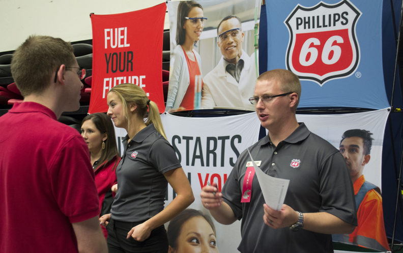 Student speaking with a Phillips 66 company representative.