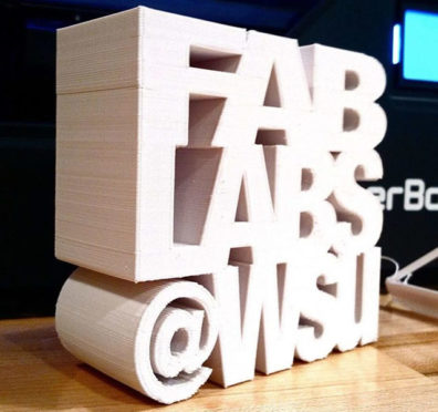 Wood sculpture forming the words Fab Labs @ WSU.