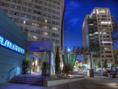Hotel Murano in the evening with glowing lights of the hotel, street and surrounding buildings