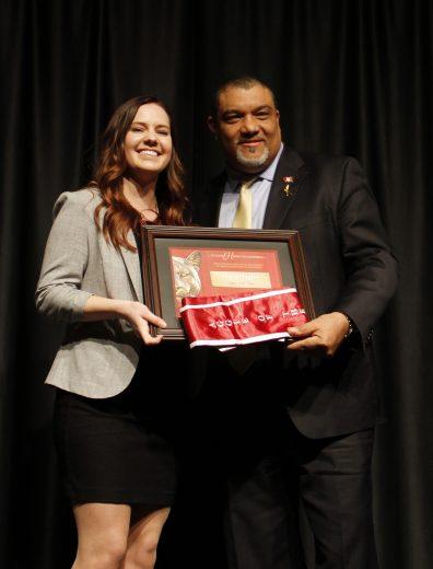 Macy Hagler receiving her award.
