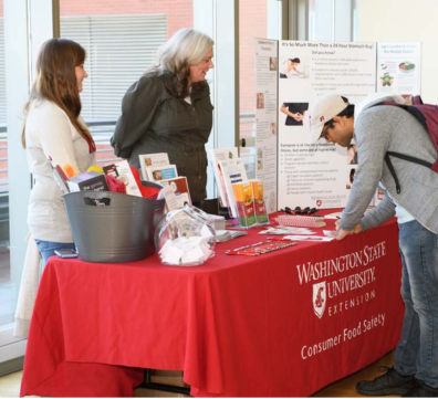 People at a WSU Consumer Food Safety booth.
