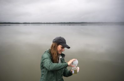 Woman taking a water sample