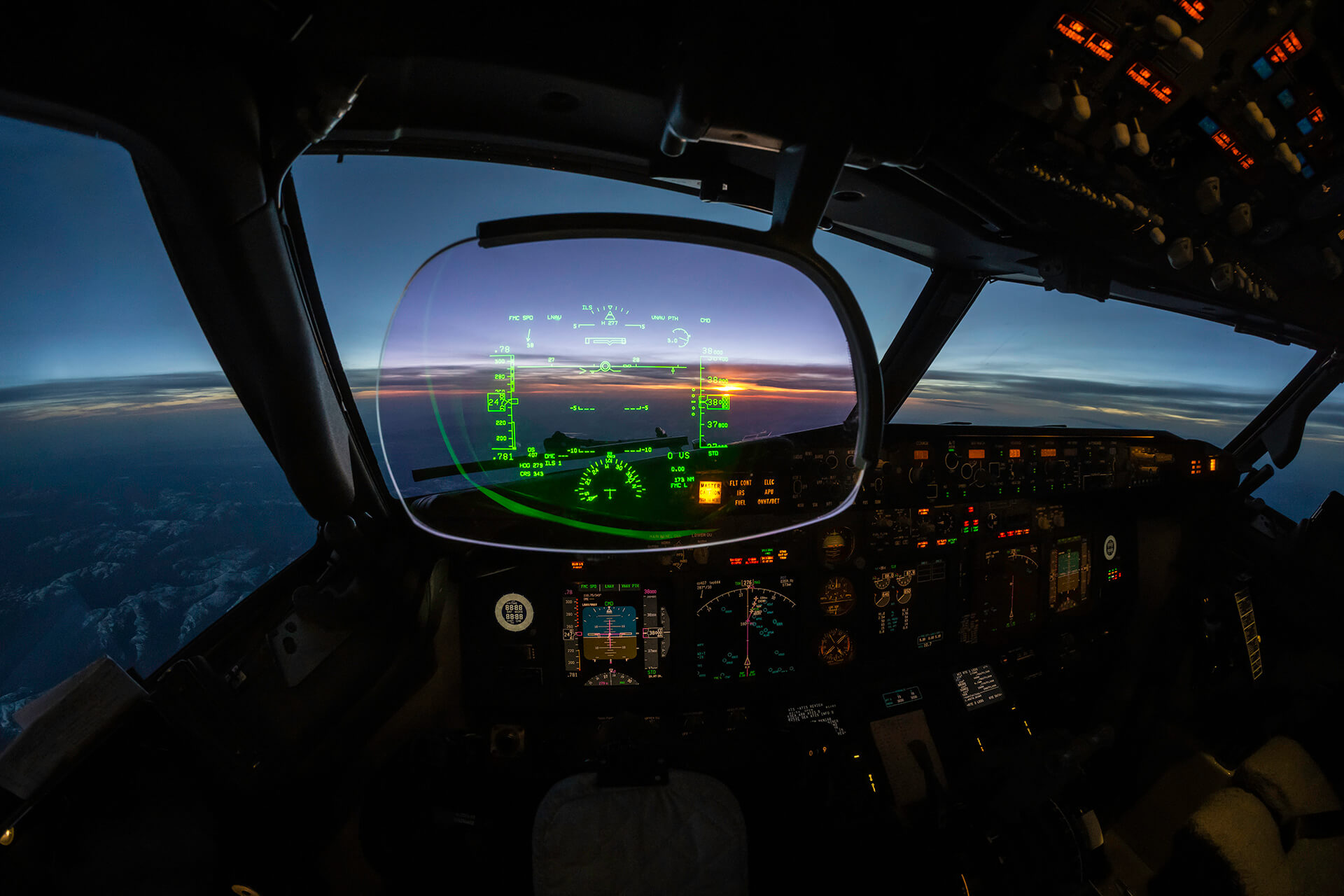 Jet cockpit and modern Heads up Guidance System at sunset