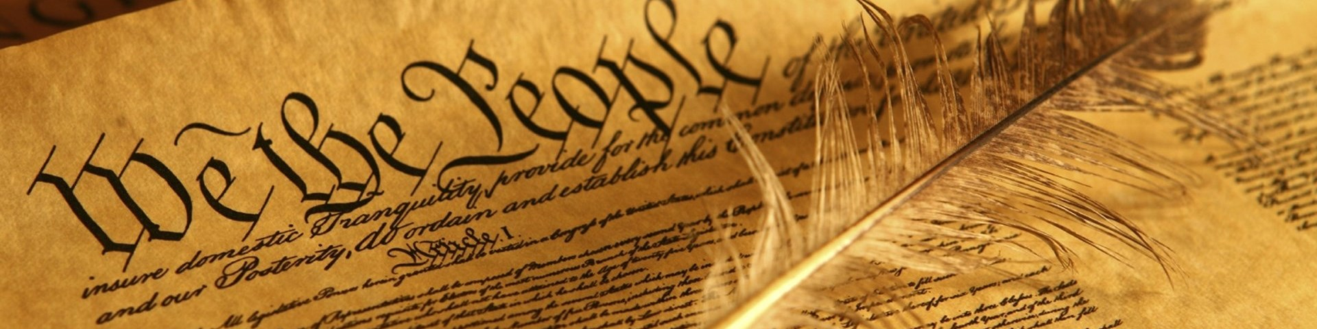 Photo: Closeup of US Constitution with feather.