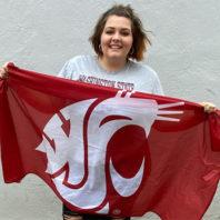 Photo: Chelsea Rollins holds Old Crimson flag.