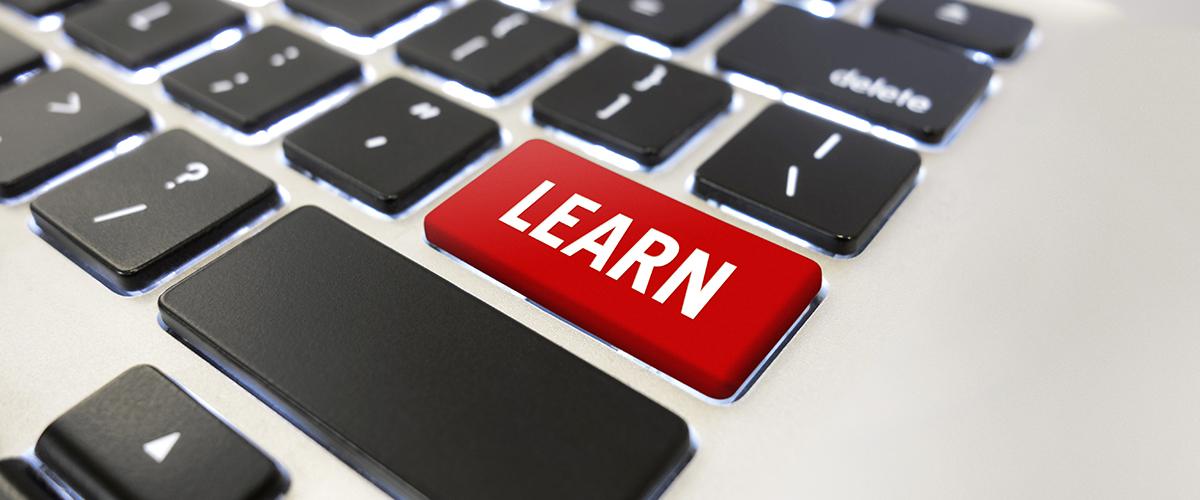 Photo: Learn Button on computer keyboard.