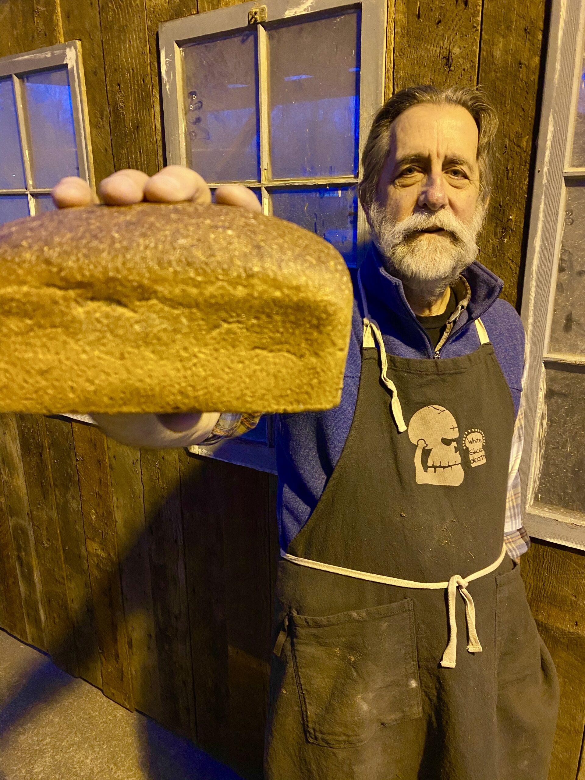 Stephen Jones holding a loaf of bread