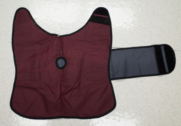Interior of vest worn by dog while Holter monitor is attached.