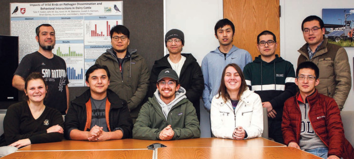 Group photo of eleven graduate students