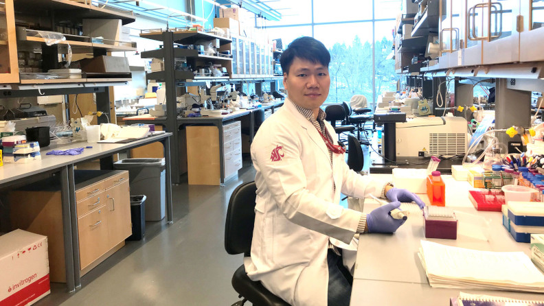 Graduate doing research in the lab