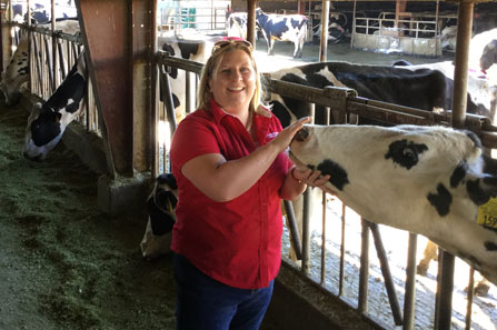 Amber Adams-Progar with dairy cow